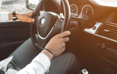 man-in-white-dress-shirt-holding-steering-wheel-804130